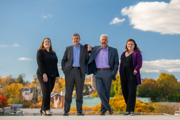 The Velnoskey Wealth Management Group of Westminster, Maryland | Team Portrait by Kelly Heck Photography on Parking Garage Rooftop